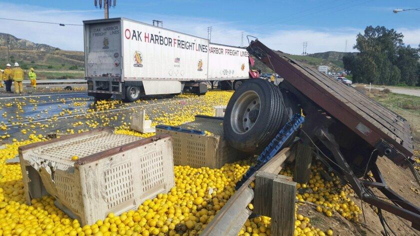 2 killed in crash involving big rig that spilled lemons
