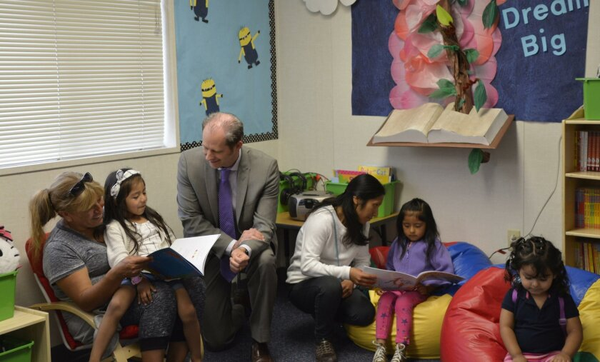 Vista USD Superintendent Dr. Devin Vodicka and parents read with kids in the new Reading Oasis at Maryland Elementary.