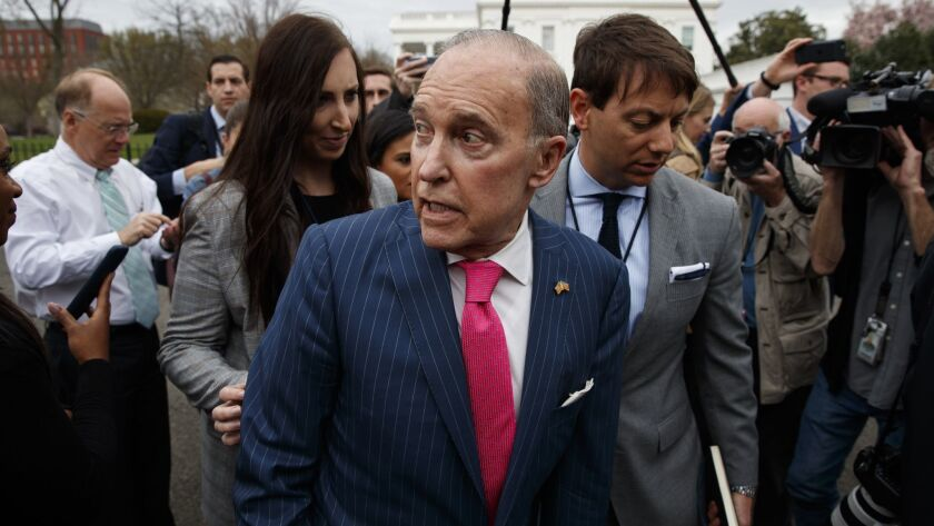 White House chief economic advisor Larry Kudlow talks with reporters outside the White House on Wednesday.