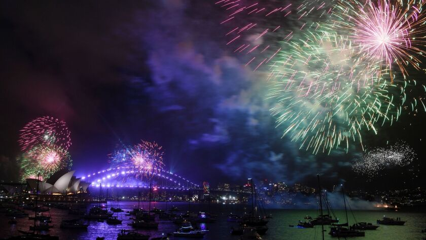 Fireworks explode over Sydney Harbour during New Year's Eve celebrations in Sydney, Sunday, Dec. 31,