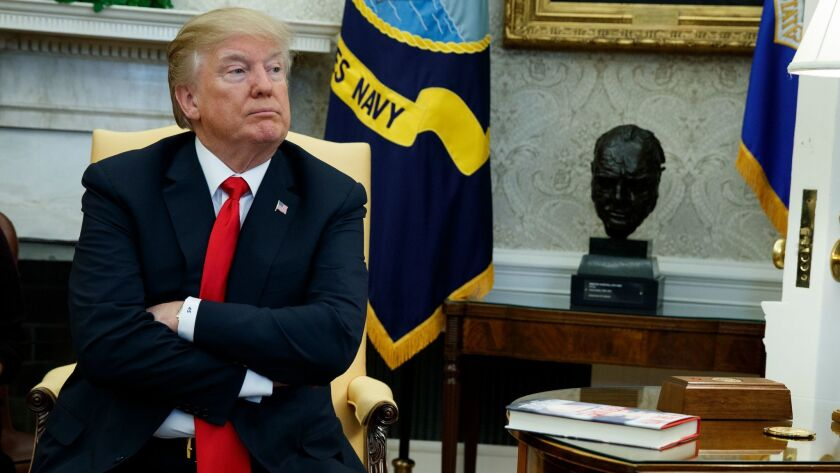 President Trump sits during a meeting where he talked with reporters about allowing the release of a secret memo on the FBI's role in the Russia inquiry in Washington on Feb. 2.