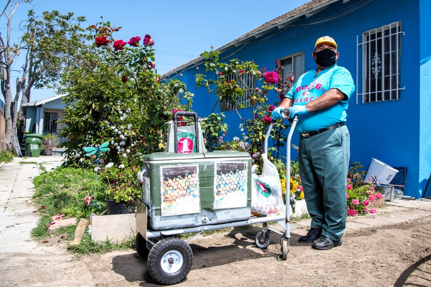 Faustino Martinez with his pushcart outside his South L.A. neighborhood.