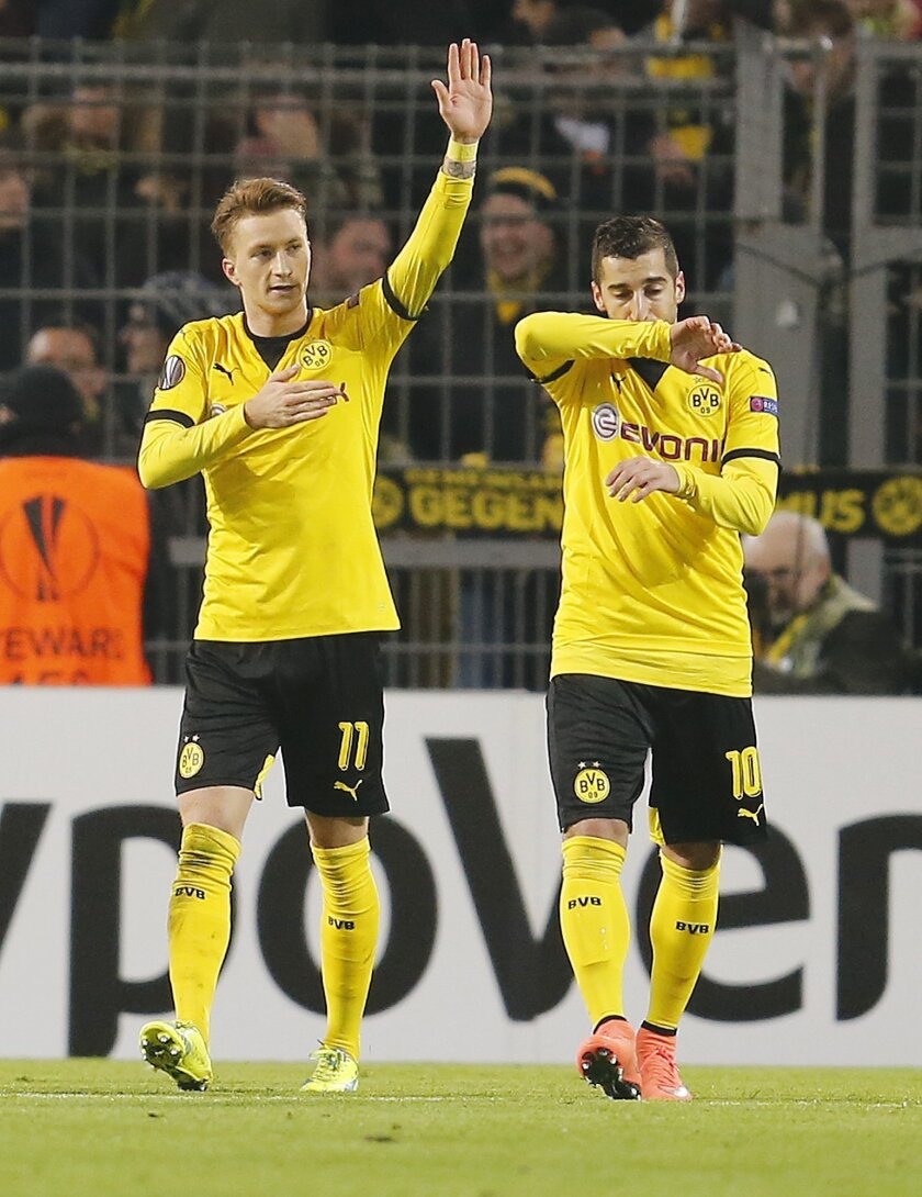 Dortmund's Marco Reus, left, celebrates his side's second goal during a Europa League round of 32 first leg soccer match between Borussia Dortmund and FC Porto the Signal Iduna Park stadium in Dortmund, Germany, Thursday, Feb. 18, 2016. (AP Photo/Michael Probst)