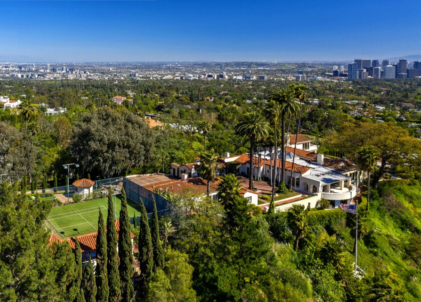 An aerial view shows LeBron James' new Beverly Hills home with the L.A. skyline in the distance.