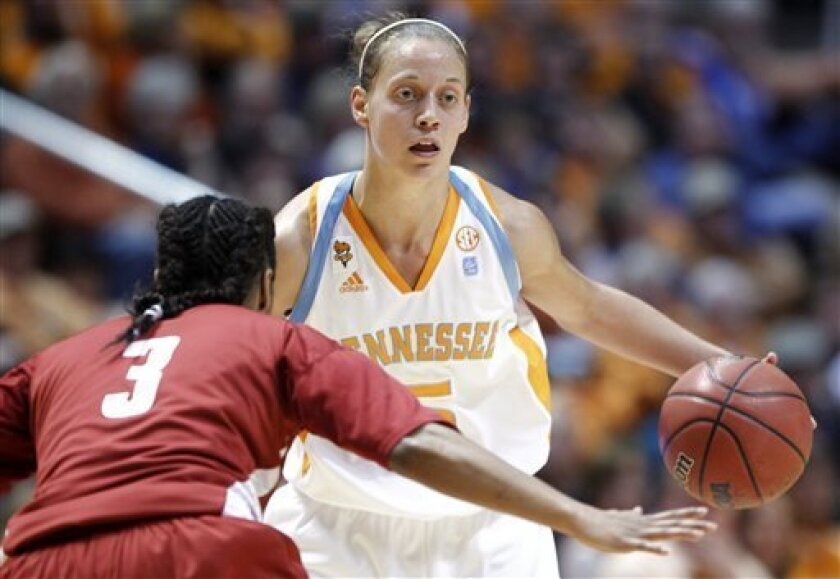 Tennessee's Angie Bjorklund (5) drives against Alabama's Jasmine Robinson (3) during the first half of an NCAA college basketball game Thursday, Jan. 6, 2011 in Knoxville, Tenn. (AP Photo/Wade Payne)