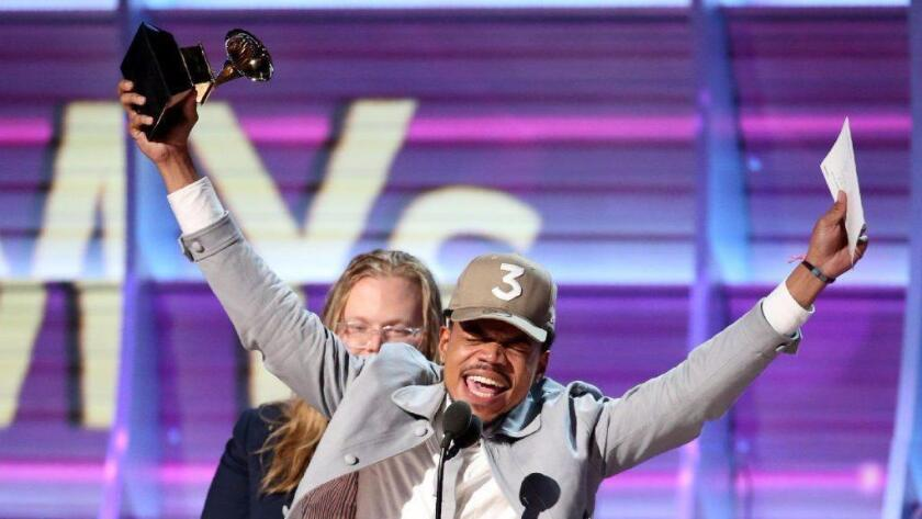"Chance the Rapper celebrates Sunday as he accepts the Grammy Award for Best Rap Album for ""Coloring Book"" at the 59th Annual Grammy Awards in Los Angeles. (Lucy Nicholson / Reuters)"
