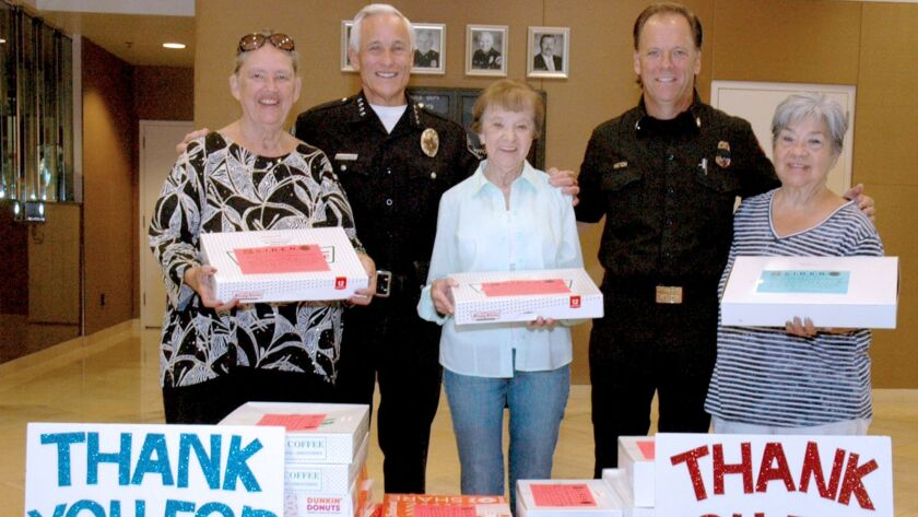 Golden Girl Cookie Brigade co-founder Sally Peterson, from left, with Police Chief Scott LaChasse, Doris Owings, Fire Department Battalion Chief Mark Hatch and Rosemary Ennis.