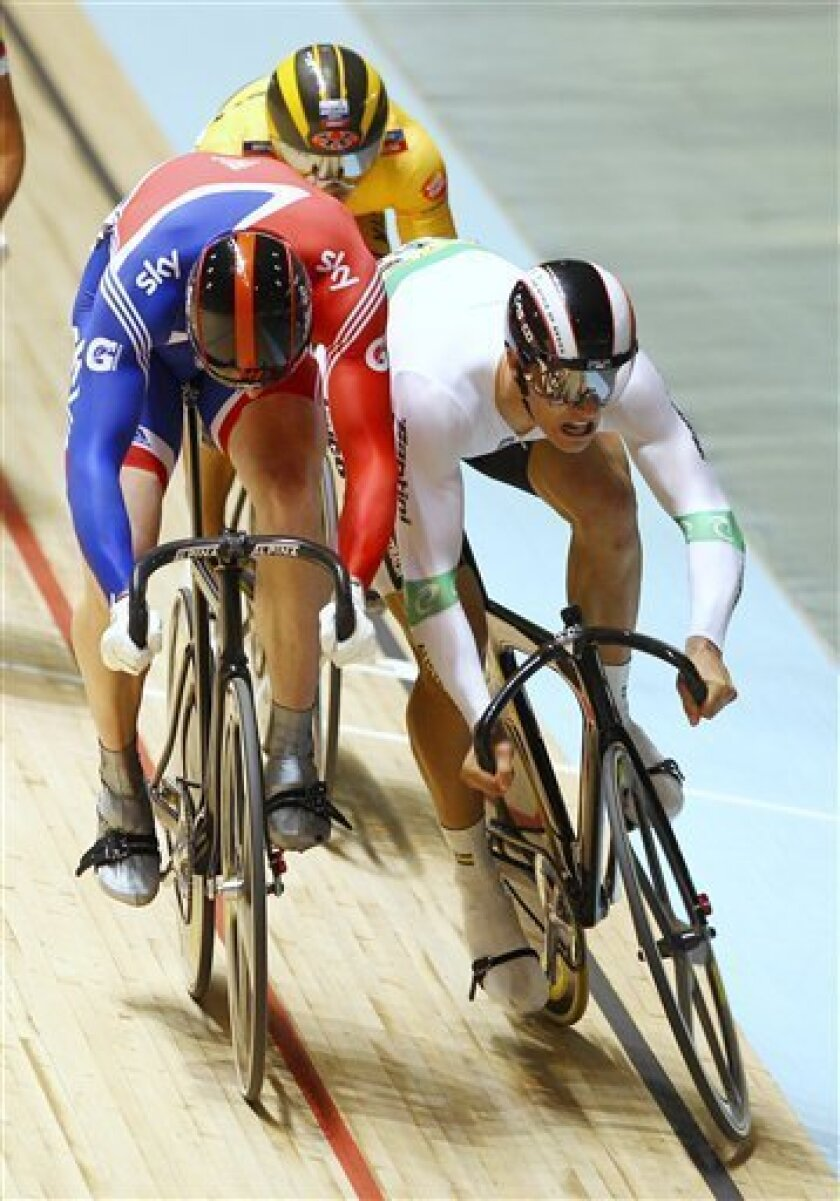 Britain's Matthew Crampton, left, and Australia's Mattew Glaetzer bump in their heat during their first round of the men's keirin at the Track Cycling World Championships in Melbourne, Australia, Sunday, April 8, 2012. (AP Photo/Rick Rycroft)