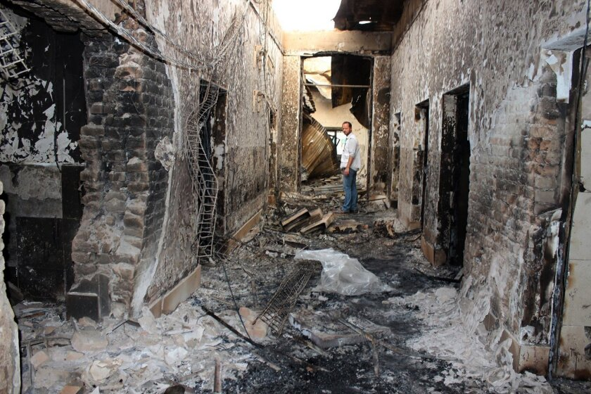 An employee of Doctors Without Borders in the charred ruins of the charity's hospital in Kunduz, Afghanistan, hit by U.S. airstrikes Oct. 3.