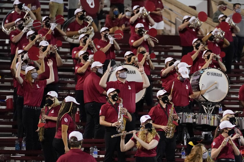 FILE - In this Saturday, Sept. 12, 2020 file photo, a reduced size Oklahoma band performs in the stands in the second half of an NCAA college football game against Missouri State in Norman, Okla. Marching bands, part of the game since its beginning more than a century ago, are idled or toned down across the country. (AP Photo/Sue Ogrocki, File)