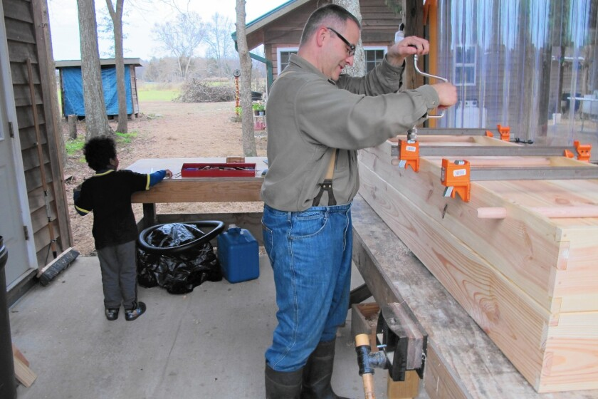 Don Byrne makes pine coffins by hand on his homestead in Bear Creek, N.C., where he lives with his wife and two children including Niko, 4.