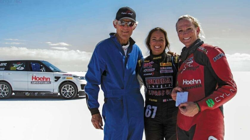 Trainer John Howard, driver Shea Holbrook, and cyclist Denise Mueller-Korenek of Project Speed after their record-setting bicycle speed run at Bonneville Salt Flats in Utah in September 2016.