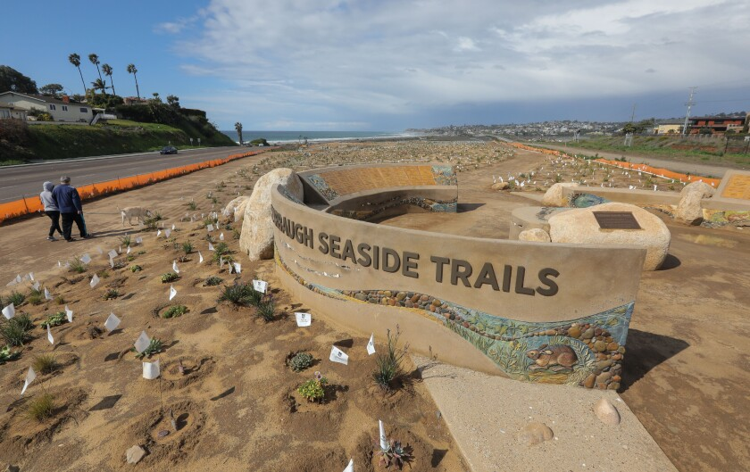 View of the new overlook at the now open Harbaugh Seaside Trails between Coast Highway 101, at left, and the railroad tracks. On Saturday evening the Nature Collective honored the many people who donated money to save the 3-acre space from development.
