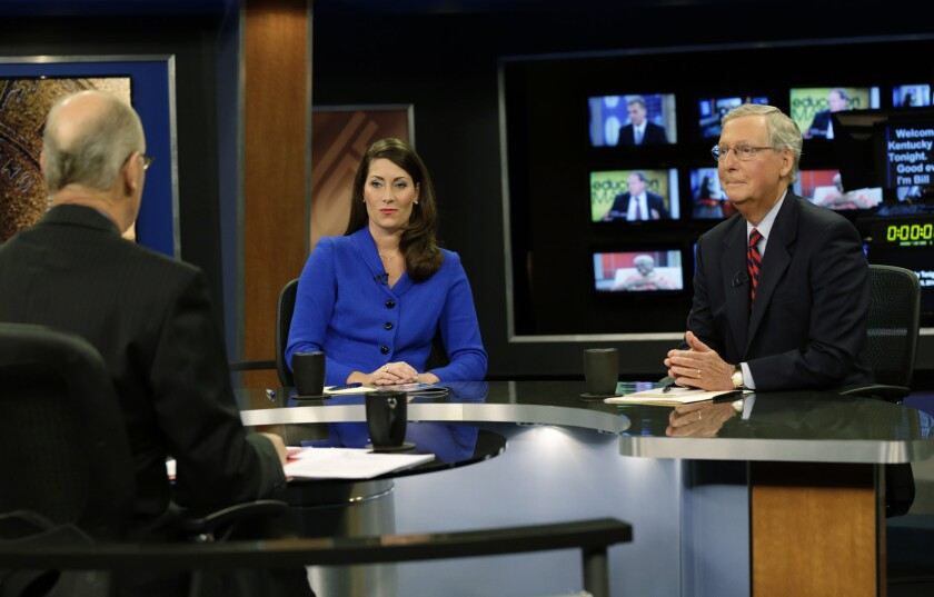 Senate Minority Leader Mitch McConnell, right, and Democratic opponent Alison Lundergan Grimes, rehearse with host Bill Goodman before their debate Monday.