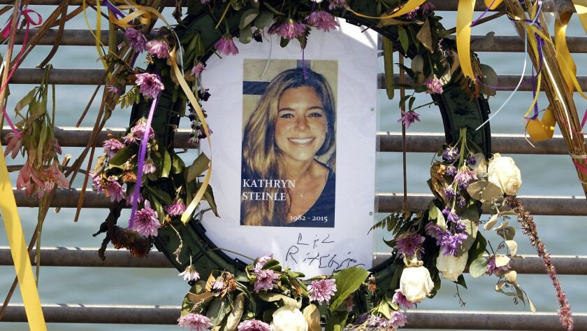 Flowers and a portrait of Kathryn Steinle at Pier 14 in San Francisco in 2015.