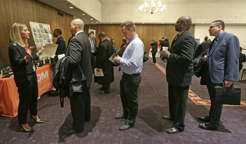 A corporate recruiter speaks with job applicants during a National Career Fairs job fair in Chicago in 2015.