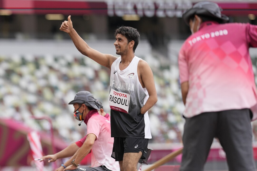 Afghanistan's Hossain Rasouli gives a thumbs up after his first attempt in the men's long jump.