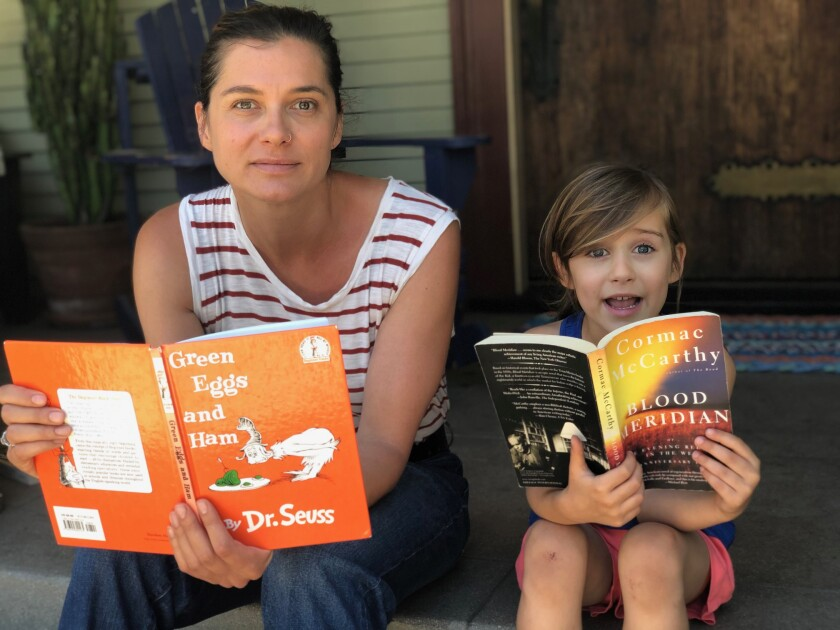 Ivy Pochoda and her daughter, Loretta, on their porch in West Adams, reading their favorite books.