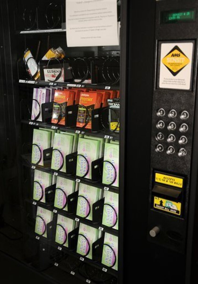 This undated photo provided by Shippensburg University shows the vending machine at Shippensburg University's Etter Health Center that provides the Plan B emergency contraceptive along with condoms, decongestants and pregnancy tests. The pill is available without a prescription to anyone 17 or older, and the school checked records and found that all current students are that age or older, spokesman Peter Gigliotti said. The pill's availability in a vending machine is so new that state officials aren't sure whether it complies with rules. (AP Photo/Shippensburg University)