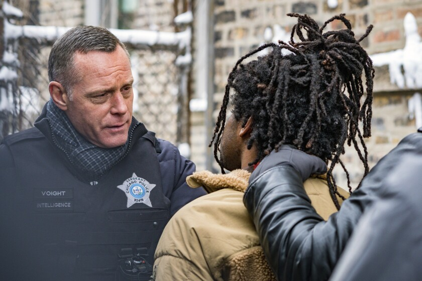 "In this image released by NBC, Jason Beghe portrays Hank Voight, left, in a scene from the crime series ""Chicago PD."" The May 25 killing of George Floyd at the hands of Minneapolis police has set off protests worldwide and transmitted images of law enforcement that long remained far outside the narratives of crime stories. (Matt Dinerstein/NBC via AP)"