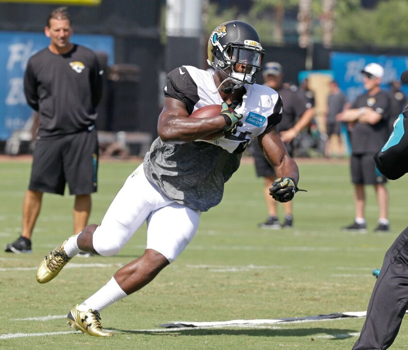 FILE - In this Aug. 6, 2015, file photo, Jacksonville Jaguars running back T.J. Yeldon runs the ball during practice at NFL football training camp in Jacksonville, Fla. Yeldon eagerly awaits his NFL debut against the Detroit Lions on Friday night, Aug. 28. (AP Photo/John Raoux, File)