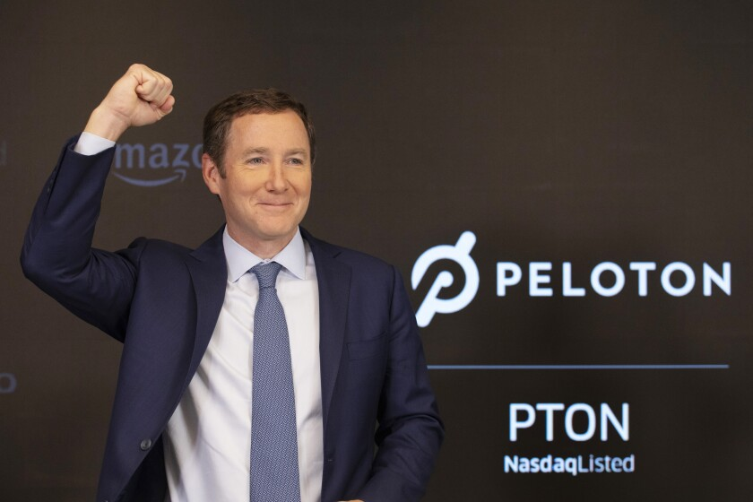 Peloton CEO John Foley celebrates at the Nasdaq MarketSite before the opening bell and his company's IPO, Thursday, Sept. 26, 2019 in New York.