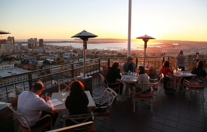 A sunset view of downtown, North Island, San Diego Bay, Point Loma and beyond awaits on the 12th-floor patio of Bertrand at Mister A's restaurant in Bankers Hill. (Union-Tribune file photo)