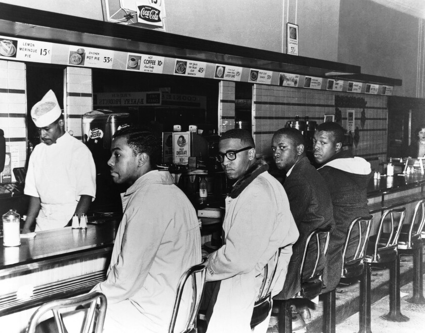 Franklin McCain, second from left, and friends sit at the Woolworth's lunch counter in Greensboro, N.C., on the second day of black students' efforts in 1960 to desegregate the counter.