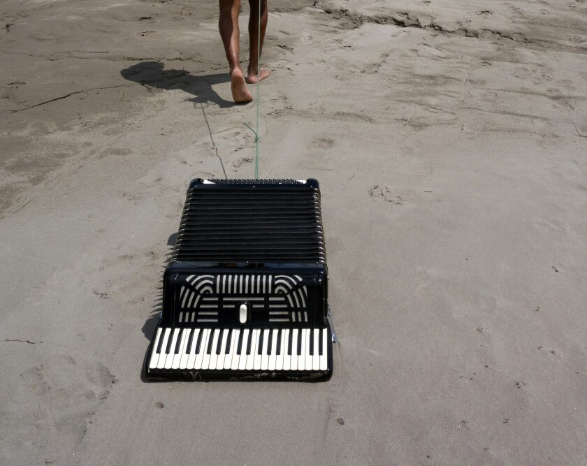 """An accordion on the sand from Los Jaichackers' """"Subterranean Homesick Cumbia"""""""
