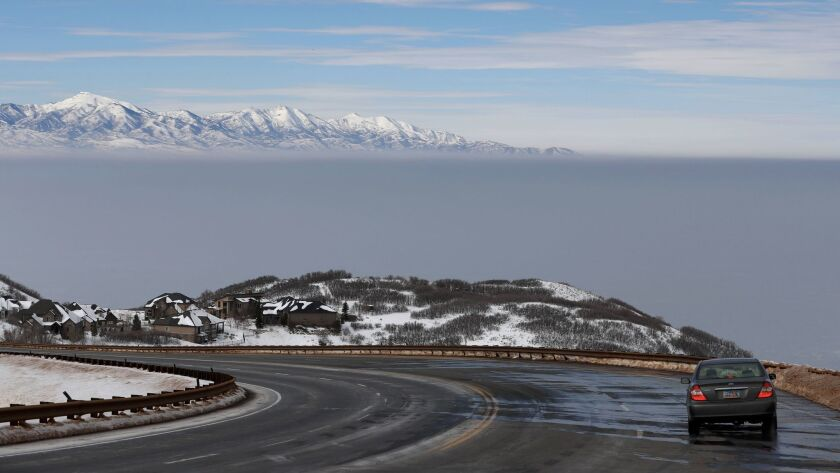 A temperature inversion, seen from Traverse Mountain, traps and fills the Salt Lake Valley with thick smog Tuesday.
