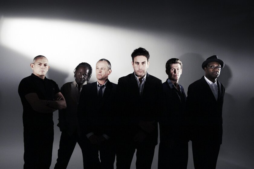 The Specials current lineup includes Lynval Golding on rhythm guitar and vocals, Horace Panter on bass, Terry Hall on vocals, Roddy Radiation on lead guitar and John Bradbury on drums, plus (in the photo above) at least one other member.