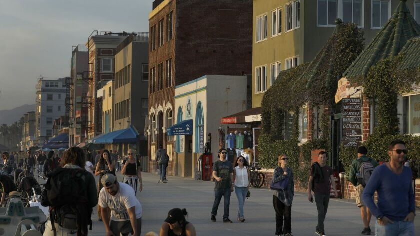 The boardwalk in Venice Beach, where property owners complained that a newly formed Business Improvement District failed to promptly provide services it had promised.