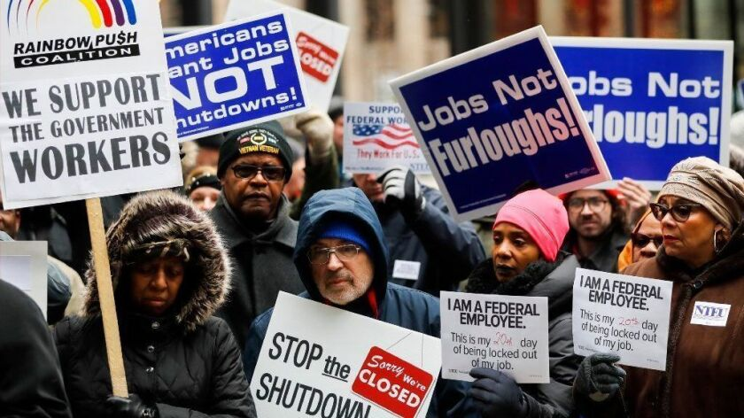 Federal workers and their supporters rally against the government shutdown Jan. 10, 2019, at Federal Plaza in Chicago.