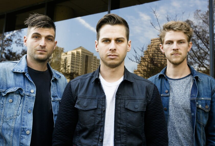 Foster The People's Cubbie Fink, Mark Foster, and Mark Pontius, from left, pose for a photograph during the SXSW Music Festival on Thursday, March 13, 2014, in Austin, Texas. (Photo by Jack Plunkett/Invision/AP)