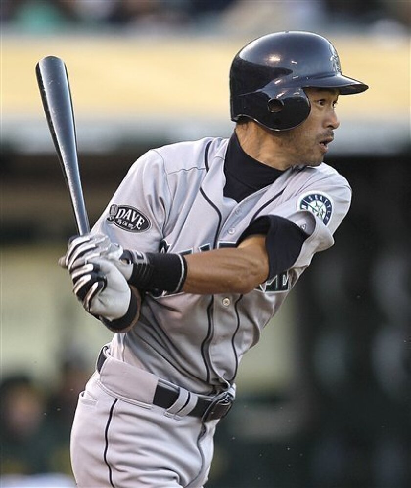 Seattle Mariners' Ichiro Suzuki, of Japan, follows through on a base hit off Oakland Athletics' Brett Anderson during the third inning of a baseball game on Saturday, April 2, 2011, in Oakland, Calif. (AP Photo/Ben Margot)