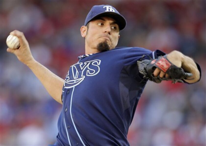 FILE - In this Oct. 9, 2010, file photo, Tampa Bay Rays starting pitcher Matt Garza throws the ball against the Texas Rangers at Game 3 of the American League Division Series in Arlington, Texas. The Chicago Cubs have a tentative trade in place to obtain Garza from the Rays, according to two people familiar with the negotiations. The Rays would receive outfielder Sam Fuld, minor league outfielder Brandon Guyer and several other prospects for Garza, who would be sent to Chicago along with prospects, the two people told The Associated Press on Friday, Jan. 7, 2011 (AP Photo/Tony Gutierrez, File)