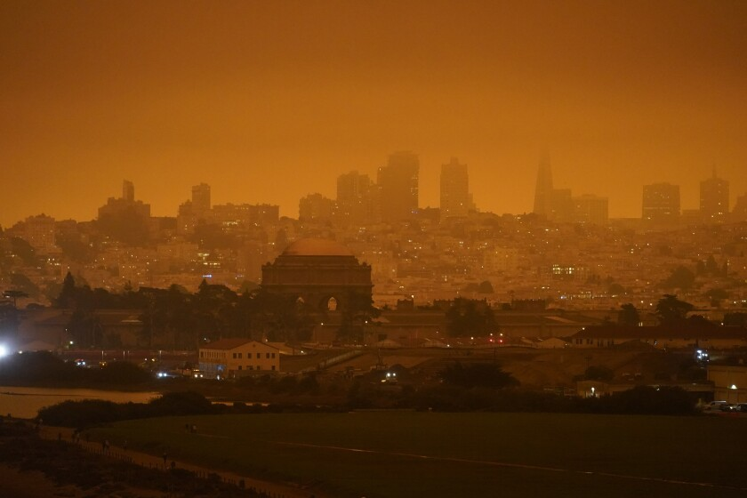 A dark orange sky above Crissy Field was caused by heavy smoke from wildfires in San Francisco last September.