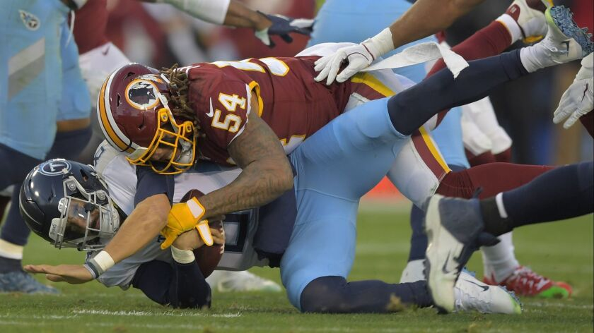 Redskins linebacker Mason Foster sacks Titans quarterback Marcus Mariota.