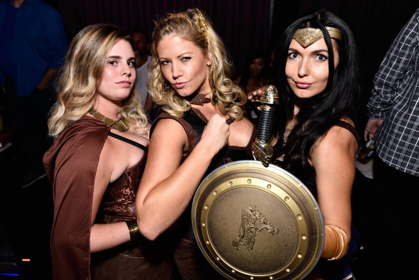 Superheros, including lots dressed as Wonder Woman, came out to party during Comic-Con at Side Bar on July 22, 2017. (Jesse Arroyo)