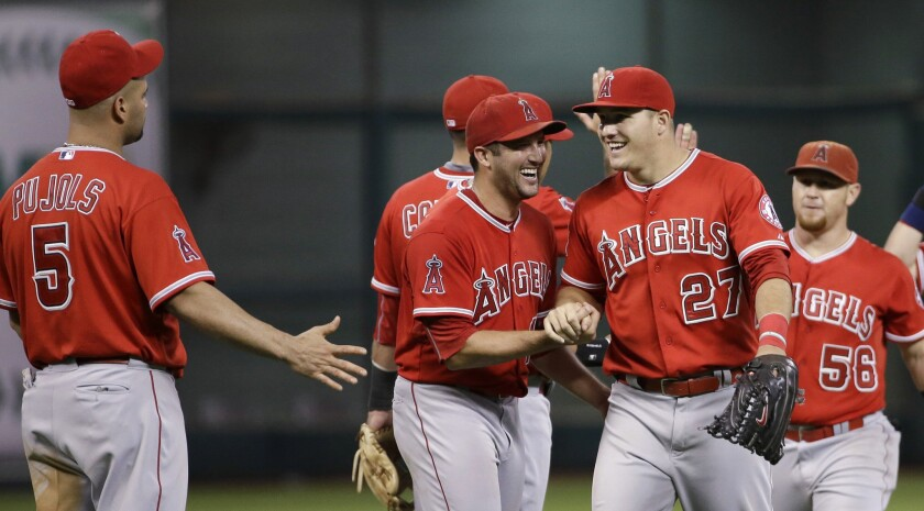 The Angels celebrate a 4-3 win over the Astros at Houston's Minute Maid Park.