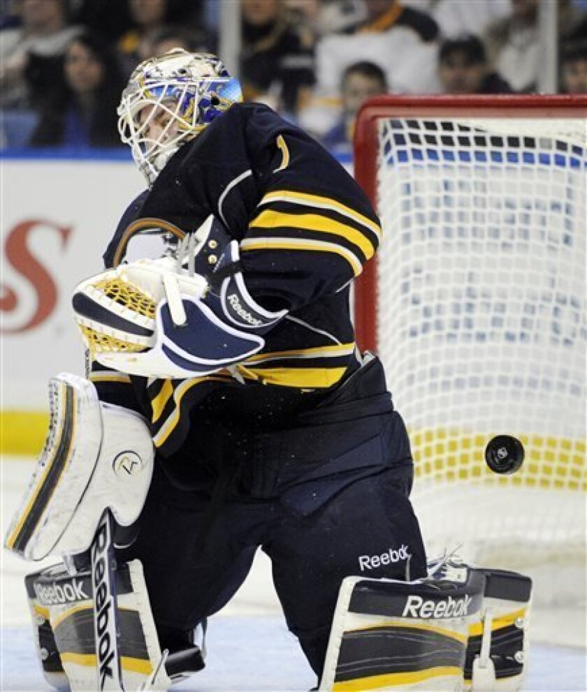 Buffalo Sabres' goaltender Jhonas Enroth (1), of Sweden, makes a save against the Washington Capitals during the second period of an NHL hockey game in Buffalo, N.Y., Saturday, March 30, 2013. (AP Photo/Gary Wiepert)