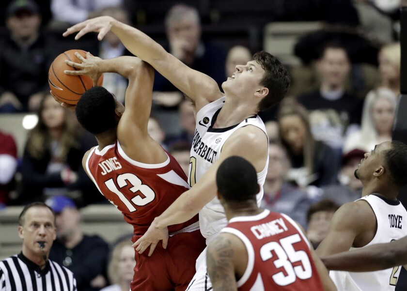 Vanderbilt forward Yanni Wetzell (1) blocks the path of Arkansas guard Mason Jones (13) during a game last season.