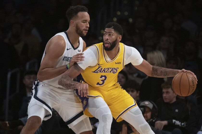 Lakers forward Anthony Davis (3) works in the post against Grizzlies forward Kyle Anderson during their game on Oct. 29, 2019.