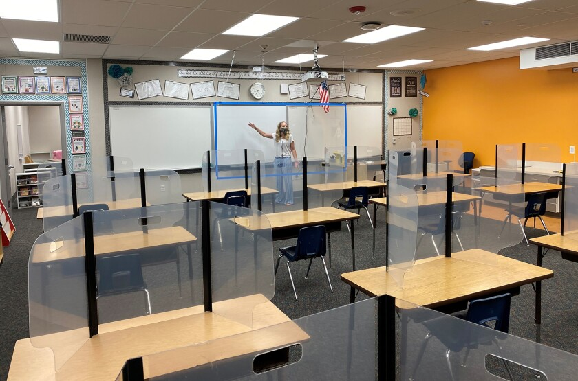 Ocean View School District Supt. Carol Hansen in a classroom with protective plastic shields.