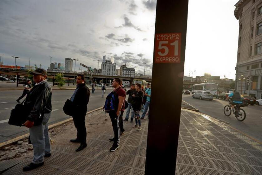 BUENOS AIRES (ARGENTINA), Nov. 27, 2018: Passengers await for the bus to come during a three-hour long strike lead by the Argentine Confederation of Transport Workers, which resulted in the suspension of transportation services such as buses, the subway, commuter trains, aircraft and boats from 4 am to 7 am. EPA/EFE/Juan Ignacio Roncoroni