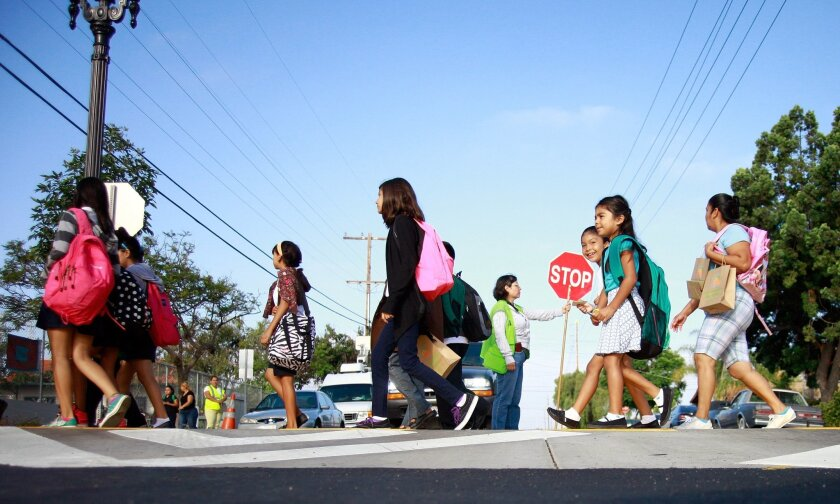 Students walk to Kimball Elementary School using Coolidge Avenue along a new community corridor recently designated a safe route to school.