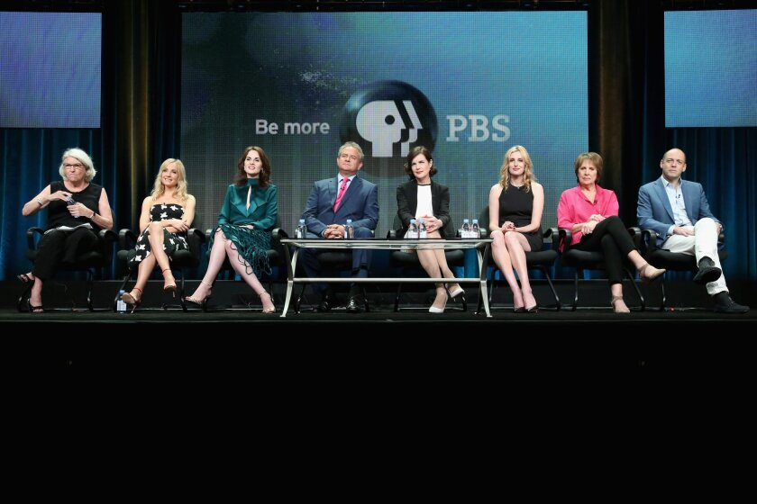 """From left, """"Masterpiece"""" executive producer Rebecca Eaton, actors Joanne Froggatt, Michelle Dockery, Hugh Bonneville, Elizabeth McGovern, Laura Carmichael, Penelope Wilton and executive producer Gareth Neame speak onstage during the """"Downton Abbey"""" panel discussion at the PBS portion of the 2015 Summer TCA Tour."""