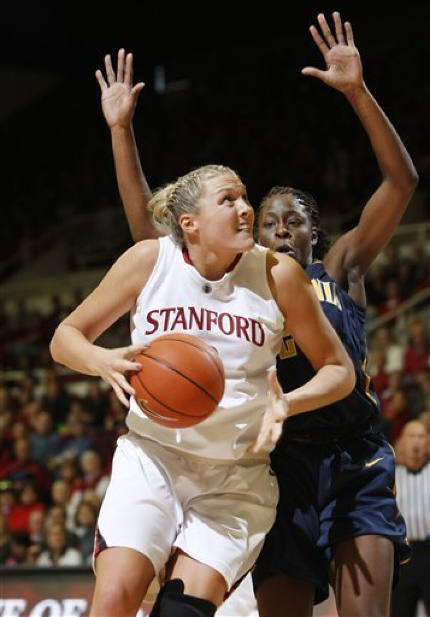 Stanford forward Jayne Appel (2) drives to the basket in front of California guard Natasha Vital (2) in the first half of an NCAA college basketball game in Stanford, Calif., Saturday, Jan. 2, 2010. (AP Photo/Paul Sakuma)