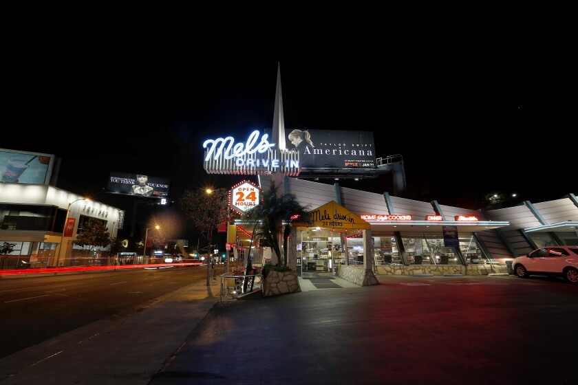 Mel's Drive-In restaurant in West Hollywood remains open by serving takeout and delivery orders even as most businesses on the Sunset Strip have closed to help curb the spread of coronavirus.
