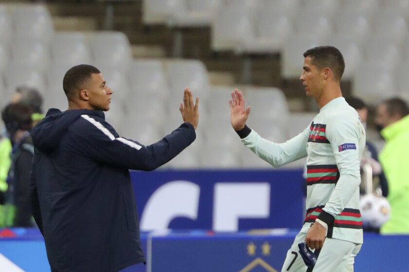 France's Kylian Mbappe and Portugal's Cristiano Ronaldo, right, greet each other at the end of the UEFA Nations League soccer match between France and Portugal at the Stade de France in Saint-Denis, north of Paris, France, Sunday, Oct. 11, 2020. (AP Photo/Thibault Camus)